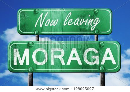 Leaving moraga, green vintage road sign with rough lettering