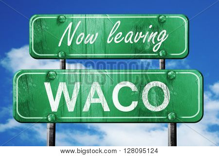 Leaving waco, green vintage road sign with rough lettering