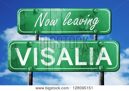 Leaving visalia, green vintage road sign with rough lettering