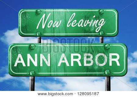 Leaving ann arbor, green vintage road sign with rough lettering