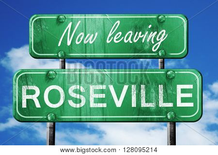 Leaving roseville, green vintage road sign with rough lettering