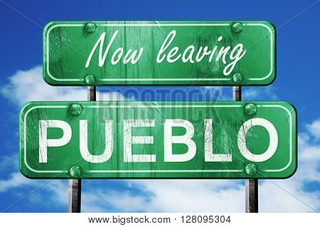 Leaving pueblo, green vintage road sign with rough lettering