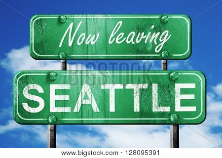 Leaving seattle, green vintage road sign with rough lettering