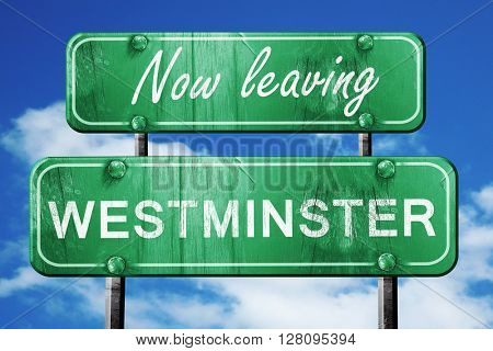 Leaving westminster, green vintage road sign with rough letterin
