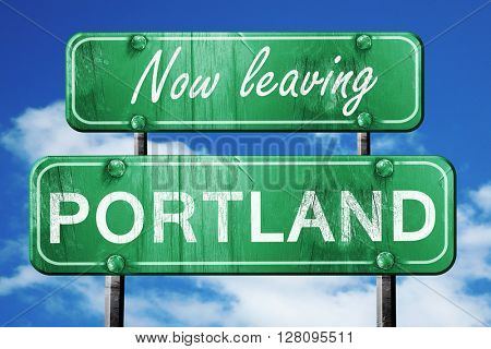 Leaving portland, green vintage road sign with rough lettering