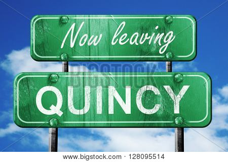 Leaving quincy, green vintage road sign with rough lettering