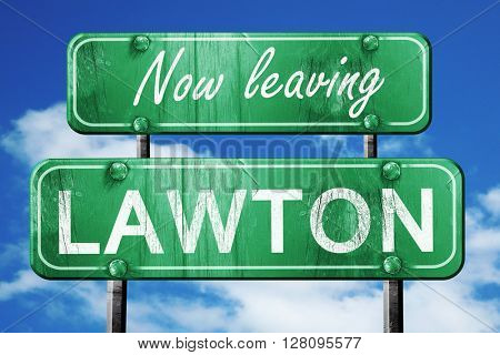 Leaving lawton, green vintage road sign with rough lettering