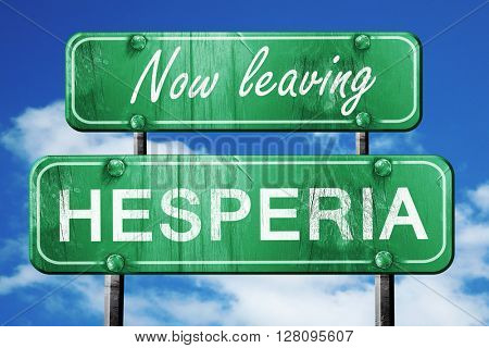 Leaving hesperia, green vintage road sign with rough lettering