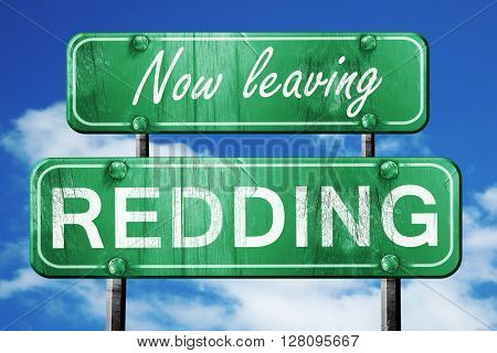 Leaving redding, green vintage road sign with rough lettering