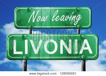 Leaving livonia, green vintage road sign with rough lettering