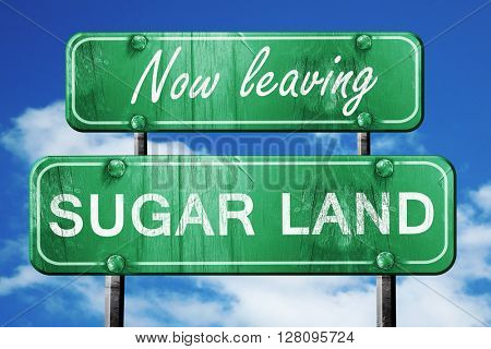 Leaving sugarland, green vintage road sign with rough lettering