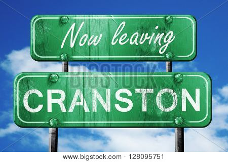 Leaving cranston, green vintage road sign with rough lettering