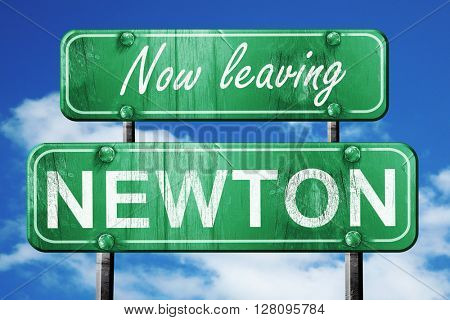 Leaving newton, green vintage road sign with rough lettering