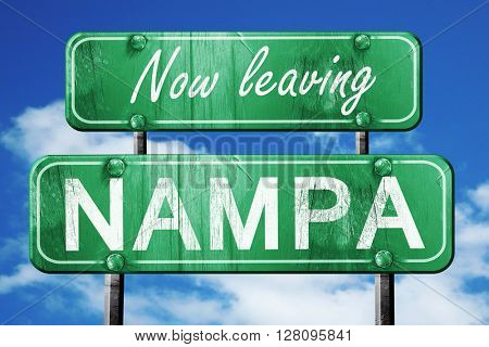 Leaving nampa, green vintage road sign with rough lettering