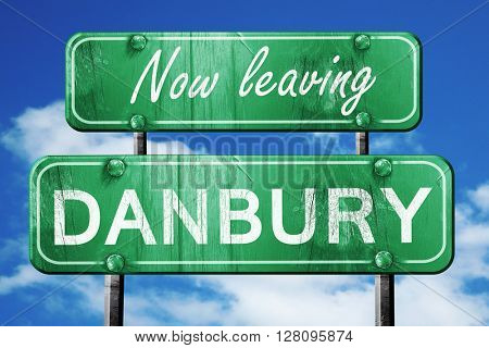 Leaving danbury, green vintage road sign with rough lettering