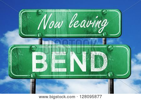 Leaving bend, green vintage road sign with rough lettering