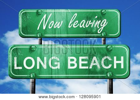 Leaving long beach, green vintage road sign with rough lettering