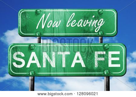 Leaving santa fe, green vintage road sign with rough lettering