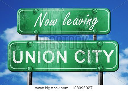 Leaving union city, green vintage road sign with rough lettering