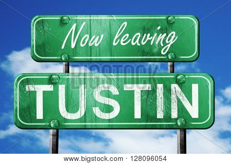 Leaving tustin, green vintage road sign with rough lettering