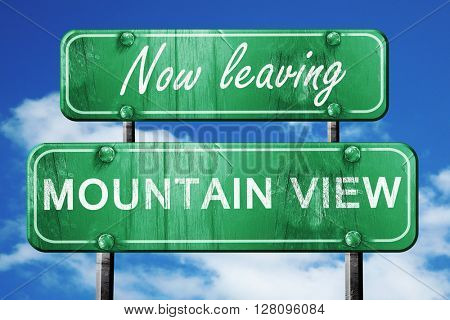 Leaving mountain view, green vintage road sign with rough letter