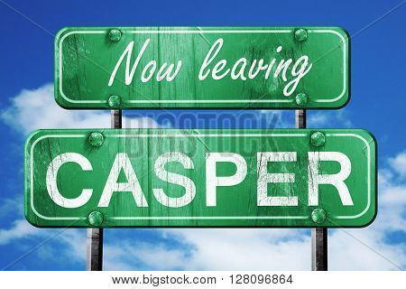Leaving casper, green vintage road sign with rough lettering