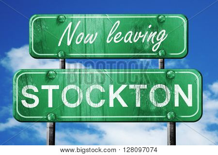 Leaving stockton, green vintage road sign with rough lettering
