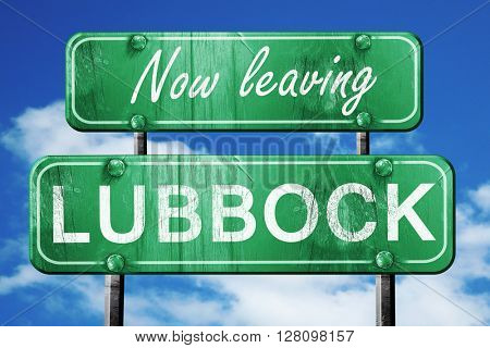 Leaving lubbock, green vintage road sign with rough lettering