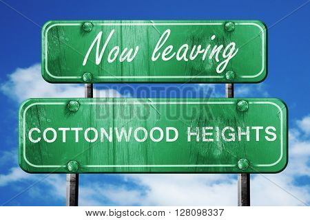 Leaving cottonwood heights, green vintage road sign with rough l