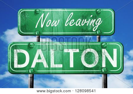 Leaving dalton, green vintage road sign with rough lettering