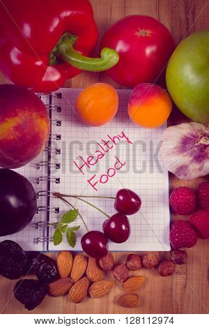 Vintage photo Fresh fruits and vegetables with notebook for writing notes concept of slimming diet and healthy nutrition