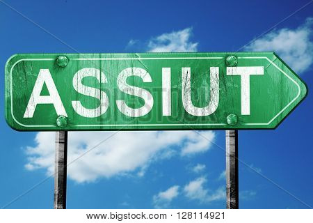assiut road sign, 3D rendering, vintage green with clouds backgr