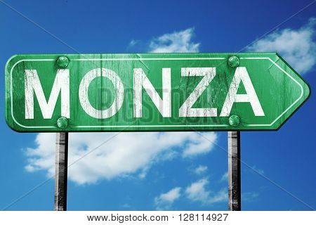 Monza road sign, 3D rendering, vintage green with clouds backgro