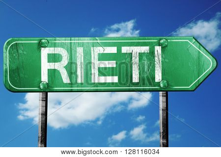 Rieti road sign, 3D rendering, vintage green with clouds backgro