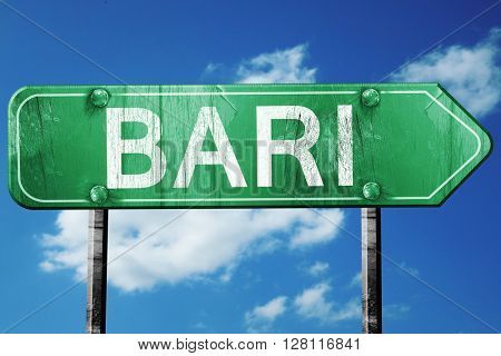 Bari road sign, 3D rendering, vintage green with clouds backgrou