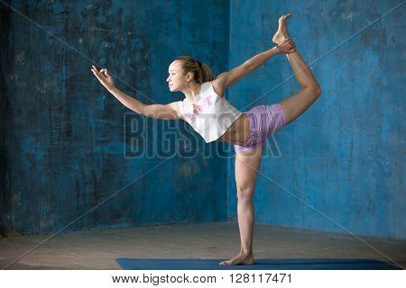 Beautiful Sporty Young Woman Doing Natarajasana