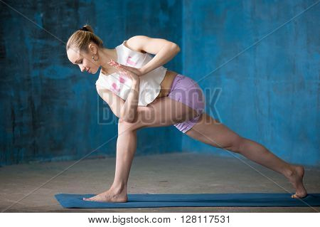 Beautiful Sporty Young Woman Doing Revolved Side Angle Pose