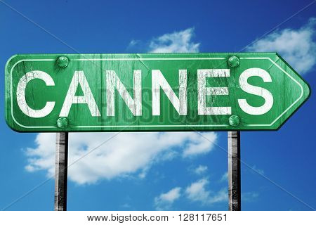 cannes road sign, 3D rendering, vintage green with clouds backgr