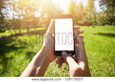 Cropped Shot Of Female Hands Holding Cell Phone With Blank Copy Space Screen For Your Text Or Inform
