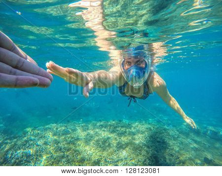 Woman snorkeling in blue sea, Beautiful woman under water before dive to coral reef, woman snorkeling in blue mask, snorkel woman face in mask, tropical sea snorkeling, summer vacation activity