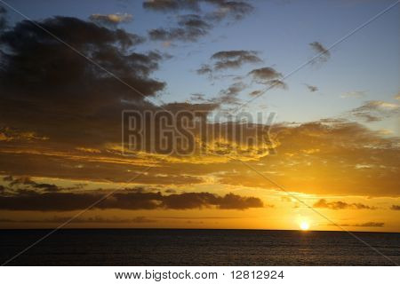 Sunset sky over the Pacific Ocean in Kihei, Maui, Hawaii, USA.