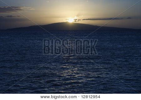 Sunset over the coast of Kihei, Maui, Hawaii, USA.
