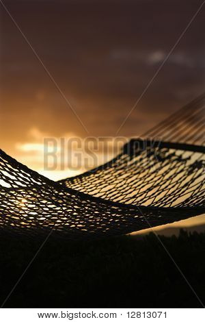 Close-up of hammock silhouette against ocean sunset in Maui, Hawaii, USA.