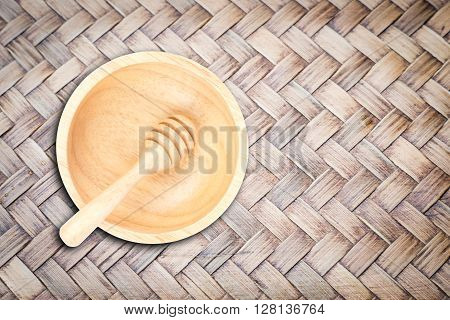 Wooden bowl and dipper on bamboo craft texture, stock photo