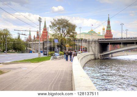 MOSCOW RUSSIA - May 02.2016: Moskva River Prechistenskaya embankment Bolshoy Kamenny Bridge and the Kremlin. Historical center of city