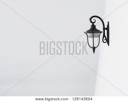 Lamp on white wall Background Abstract architecture details Black and white