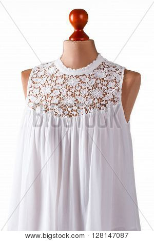 White top with lace insert. White summer top on mannequin. Lady's light clothing in stock. Custom made garment for summer.