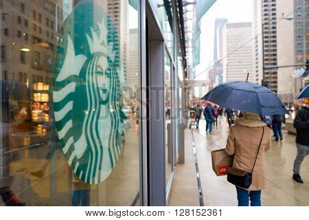 CHICAGO, IL - CIRCA APRIL, 2016: exterior of Starbucks Cafe. Starbucks Corporation is an American global coffee company and coffeehouse chain based in Seattle, Washington