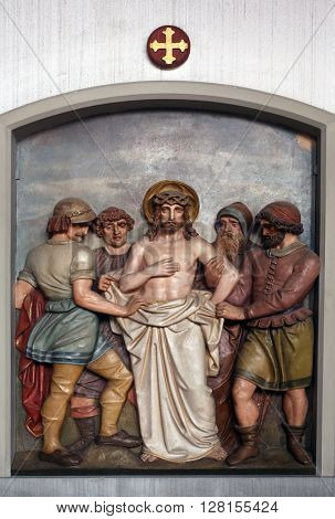 OBERSTAUFEN, GERMANY - OCTOBER 20: Jesus is stripped of His garments, 10th Stations of the Cross, the parish church of St. Peter and Paul in Oberstaufen, Germany on October 20, 2014.