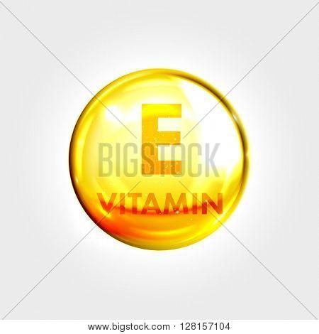 Vitamin E gold icon. Vitamin drop pill capsule. Shining golden essence droplet. Beauty treatment nutrition skin care design. Vector illustration.